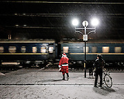 The Bennetts travel to Ukraine over the New Year holiday to visit Megan.  St. Nicholas waits for the train on New Year's Eve.
