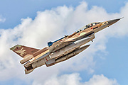 "Israeli Air Force (IAF) General Dynamics F-16D in flight with a blue sky background. Photographed at the ""Blue-Flag"" 2017, an international aerial training exercise hosted by the Israeli Air Force (IAF) at Ouvda airfield, Israel. November 2017"