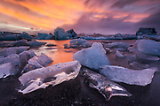 February 08 – Stunning morning at Jökulsárlón glacier lagoon, fresh blue icebergs are a great contrast to the orange sunrise colors. <br />