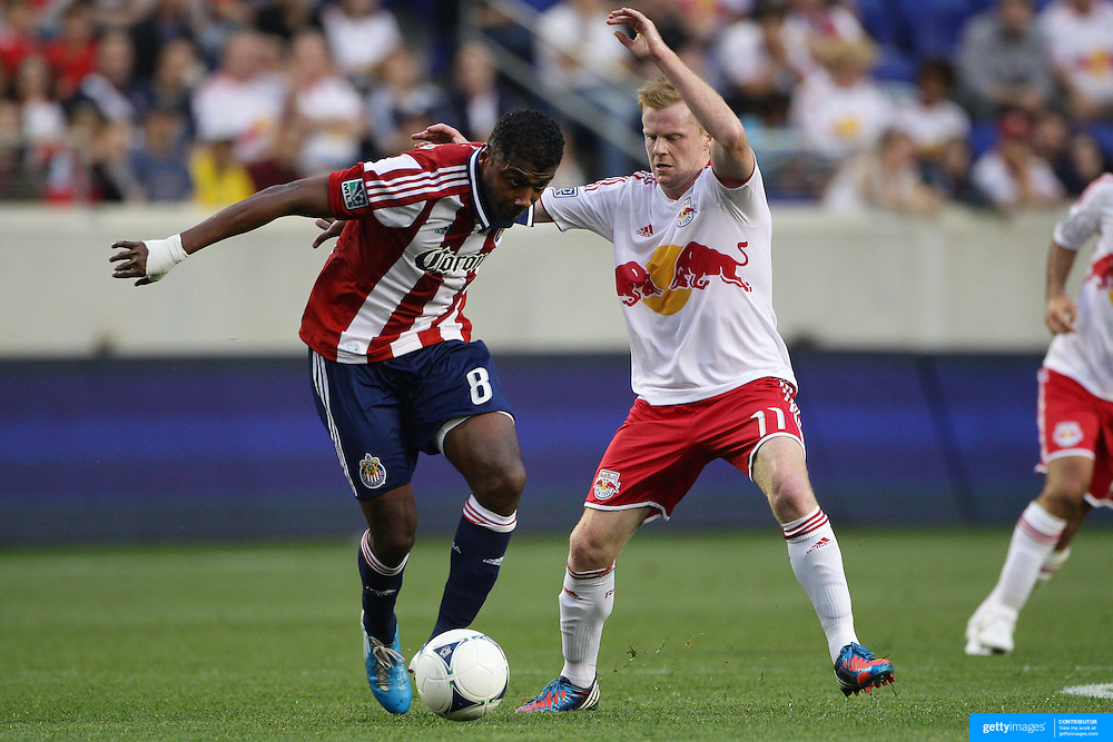 Oswaldo Minda, Chivas, USA, (left) is challenged by Dax McCarty, New York Red Bulls, during the New York Red Bulls V Chivas USA Major League Soccer match at Red Bull Arena, Harrison, New Jersey, 23rd May 2012. Photo Tim Clayton