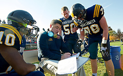Penn Charter Quakers players listen as a coach draws up plays. (Bas Slabbers/for NewsWorks)<br /> <br /> http://www.newsworks.org/index.php/local/item/61732-127th-pcga-day-ends-with-thrilling-football-game-overall-tie-gallery