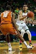WACO, TX - JANUARY 25: Isaiah Austin #21 of the Baylor Bears shoots a three-pointer against the Texas Longhorns on January 25, 2014 at the Ferrell Center in Waco, Texas.  (Photo by Cooper Neill/Getty Images) *** Local Caption *** Isaiah Austin