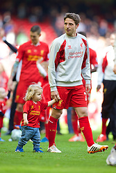 LIVERPOOL, ENGLAND - Sunday, May 11, 2014: Liverpool's Joe Allen with his son Alfie during the Premiership match against Newcastle United at Anfield. (Pic by David Rawcliffe/Propaganda)