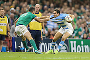 Rob Kerney of Ireland and Joaquin Tuculet of Argentina fight for the ball during the Rugby World Cup Quarter Final match between Ireland and Argentina at Millennium Stadium, Cardiff, Wales on 18 October 2015. Photo by Shane Healey.