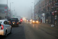 © Licensed to London News Pictures. 06/02/2020. London, UK. Vehicles travel through dense fog in north London. Photo credit: Dinendra Haria/LNP