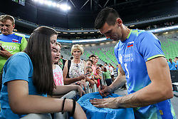 Alen Sket of Slovenia and a fan after volleyball match between National teams of Slovenia and Belgium in 2nd Round of 2018 FIVB Volleyball Men's World Championship qualification, on May 28, 2017 in Arena Stozice, Ljubljana, Slovenia. Photo by Morgan Kristan / Sportida