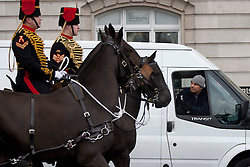 © Licensed to London News Pictures. 06/02/2012. LONDON, UK. A 'white van man' films with his mobile phone as soldiers and guns of the Kings Troop Royal Horse Artillery ride around Marble Arch after firing a 41 gun salute in Hyde Park. Gunners of the Kings Troop, based at St John's Wood since 1947, today (06/02/12) left their barracks for the last time to fire their guns in Hyde Park, the soldiers will move tomorrow to their new home in Woolwich. Photo credit: Matt Cetti-Roberts/LNP