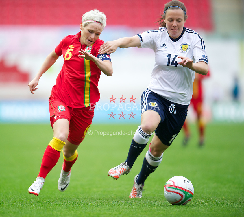 LLANELLI, WALES - Saturday, September 15, 2012: Wales' captain Jessica Fishlock in action against Scotland's Rachel Corsie during the UEFA Women's Euro 2013 Qualifying Group 4 match at Parc y Scarlets. (Pic by David Rawcliffe/Propaganda)