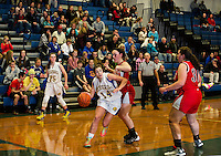 Gilford's Madison Harris gets around Moultonboro's Megan Duddy during first round game action at the 42nd annual Holiday Basketball Tournament Monday evening.  (Karen Bobotas/for the Laconia Daily Sun)
