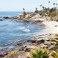 High-key photo of Laguna Beach California beach at Heisler Park along the Pacific Ocean. Laguna Beach is a seaside beach community in Orange County Southern California.