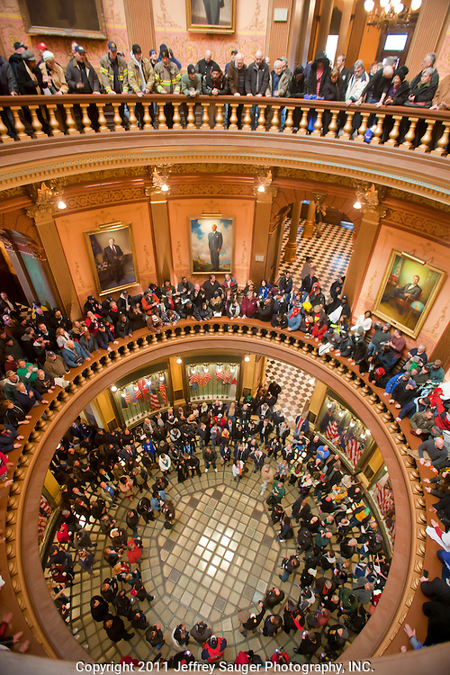 "Protestors fill the rotunda inside the Michigan State Capital during a protest against Emergency Financial Manager legislation at the Michigan State Capital in Lansing, MI, Tuesday, March 8, 2011. According to the law, which has already been approved in the House, the governor will be able to declare ""financial emergency"" in towns or school districts and appoint someone to fire local elected officials, break contracts, seize and sell assets, and eliminate services. Under the law whole cities or school districts could be eliminated without any public participation or oversight. (Jeffrey Sauger)"