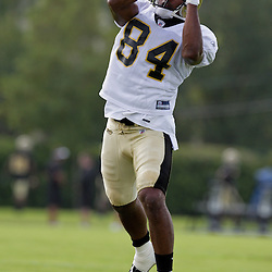 01 August 2009: New Orleans Saints wide receiver D'Juan Woods (84) catches a ball during New Orleans Saints training camp at the team's practice facility in Metairie, Louisiana.
