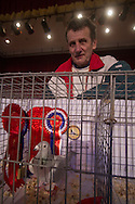 Norman Perry, from Port Talbot, south Wales, pictured with his pigeon which won the Supreme Champion award at the annual Royal Pigeon Racing Association Show of the Year at the Winter Gardens, Blackpool. The two-day show takes place each year in Blackpool and attracts 4000 entries from pigeon fanciers from all over the world. The two-day event attracted 20,000 competitors and spectators.