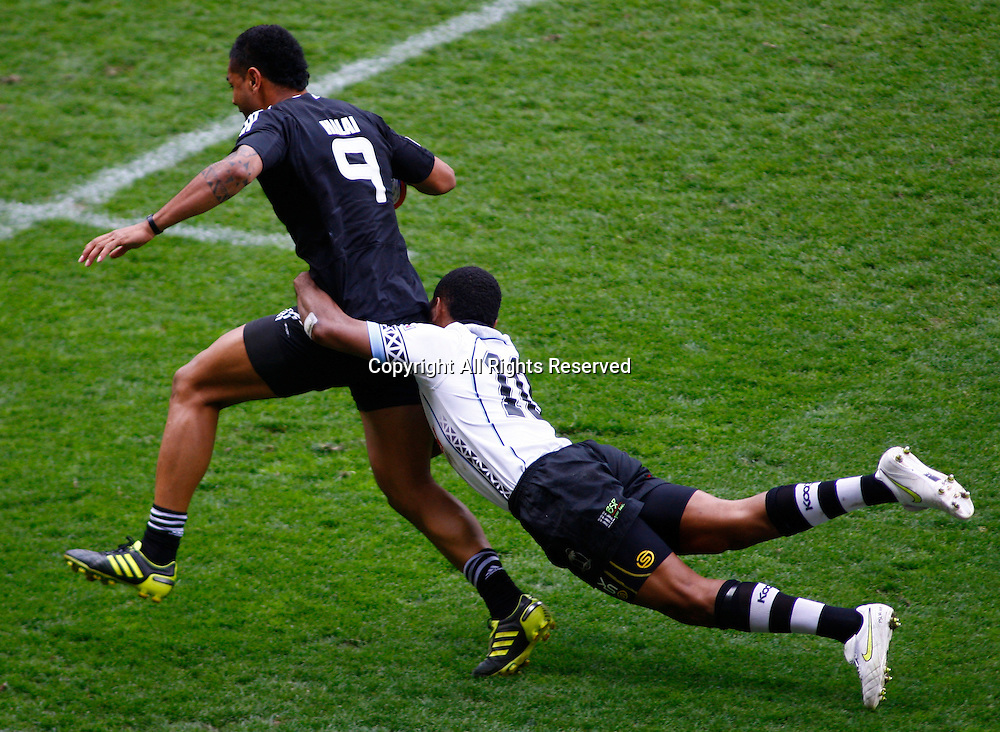 22/05/2011 TWICKENHAM ENGLAND. New Zealand's Frank Halai is tackled by Fiji's Metuisela Talebula  during the HSBC Rugby World 7s series played at Twickenham Stadium.