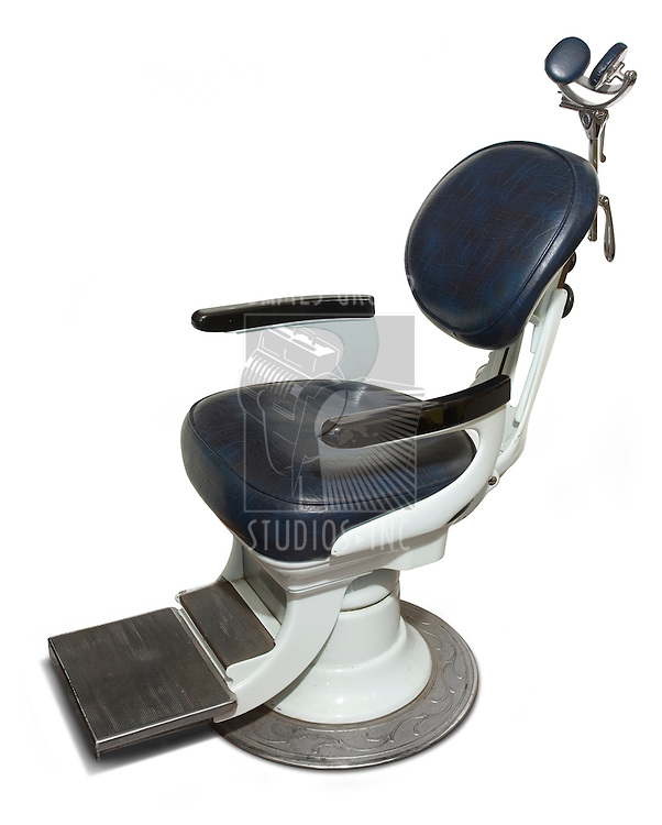 Retro dental chair isolated on a white background