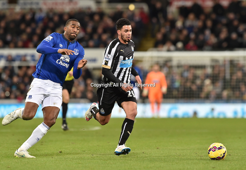 28.12.2014. Newcastle, England. Premier League. Newcastle versus Everton. Sylvain Distin of Everton challenges Emmanuel Riviere of Newcastle United for the ball