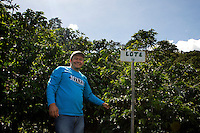 Wilmar Velasquez, overlooks the coffee fields of his finca San Carlos in the Vereda Las Andes in the municipality of Salgar in southwest Antioquia. The coffee finca of 4 Ha. has been in the family for several generations and Wilmar returned here seven years ago after the family had to flee the violence 20 years ago. He mostly works in the fields himself as well, and he has two men working permanently for him besides several more during harvest times.