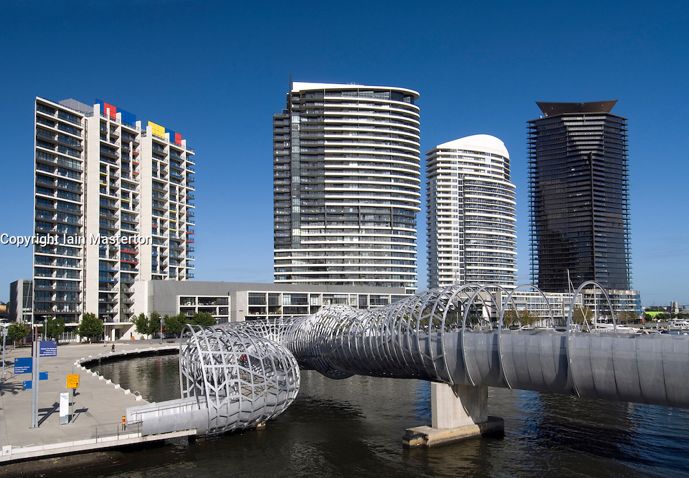View of spectacular Webb steel footbridge and modern apartment buildings in Docklands district of Melbourne Australia