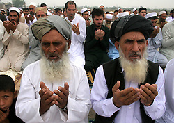 Image ©Licensed to i-Images Picture Agency. 28/07/2014. Peshawar. Pakistan. <br /> 61981792<br /> Afghan refugees offer Eid al-Fitr prayers on the outskirts of northwest Pakistan's Peshawar, on July 28, 2014. Muslims around the world celebrate the Eid al-Fitr festival, marking the end of the fasting month of Ramadan. Picture by  imago / i-Images<br /> UK ONLY