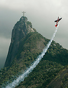 Rio de Janeiro, BRAZIL - A pilot flys past the statue of 'CHRIST THE REDEEMER' and Corcovado mountain in Rio de Janeiro on April 19, 2007. Brazil's statue of 'Christ the Redeemer' was selected as one of the modern day 'SEVEN WONDERS OF THE WORLD' by over 100 million internet and phone voters, announced July 7, 2007. Originally inaugurated in 1931, the 38-meter statue (125 ft) is located atop Crocovado mountain in the Tijuca forest, at a height of 710-meter (2,330 ft).  <br /> ©Exclusivepix