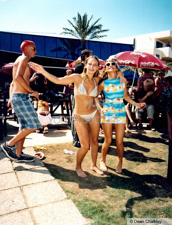 Two girls wearing a bikini and sun dress Ibiza 1999
