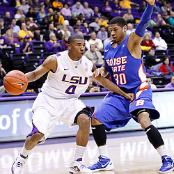 December 10, 2011; Baton Rouge, LA; LSU Tigers guard Chris Bass (4) is defended by Boise State Broncos guard Westly Perryman (30) during the first half of a game at the Pete Maravich Assembly Center.  Mandatory Credit: Derick E. Hingle-US PRESSWIRE