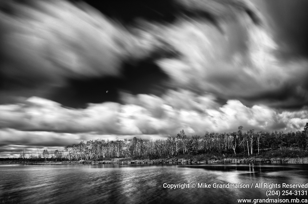 clouds moving over White Lake during windy autumn  day, Whiteshell Provincial Park, Manitoba, Canada