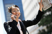 Businesswoman Hailing Taxi