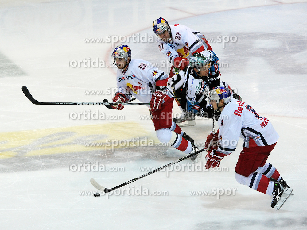 15.01.2012, Keine Sorgen Eisarena, Linz, AUT, EBEL, EHC Liwest Black Wings Linz vs EC Red Bull Salzburg, at the picture Philipp Lukas (Liwest Black Wings Linz, #21) and Alexander Pallestrang, Erick Reitz, Jeremy Wililiams, (EC Red Bull Salzburg, #6, #37, #86), during the Erste Bank Icehockey League, Keine Sorgen Eisarena, Linz, Austria, 2012-01-15, EXPA Pictures © 2012, PhotoCredit: EXPA/ Reinhard Eisenbauer