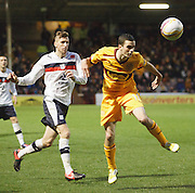 Motherwell's Jamie Murphy  wins a header as Dundee' Iain Davidson watches - Motherwell v Dundee at Fir Park in the Clydesdale Bank Scottish Premier League.. - © David Young - www.davidyoungphoto.co.uk - email: davidyoungphoto@gmail.com