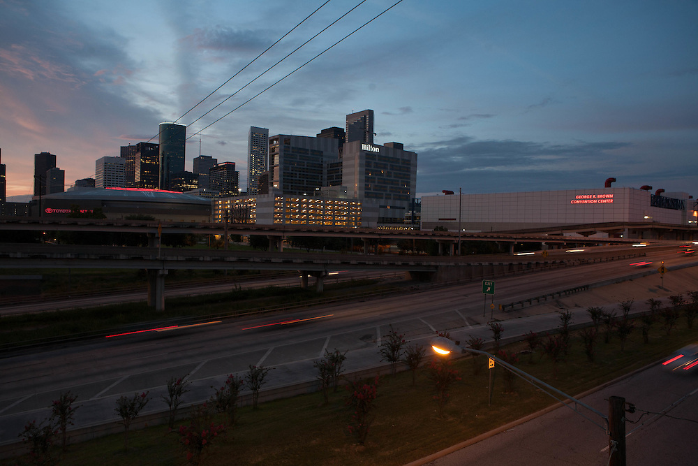 Downtown Houston, Texas from the eastside with freeway in foreground at dusk.