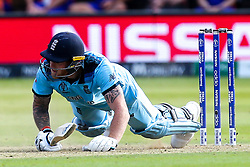 Ben Stokes of England falls over after digging out a yorker from James Neesham of New Zealand - Mandatory by-line: Robbie Stephenson/JMP - 14/07/2019 - CRICKET - Lords - London, England - England v New Zealand - ICC Cricket World Cup 2019 - Final