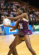 Romeda Aiken positions herself for a shot. ANZ Netball Championship. Round 3 - Queensland Firebirds v Central Pulse. Played at Brisbane Convention Centre. Firebirds (56) defeated the Pulse (28).  Photo: Warren Keir (SMP/Photosport NZ).<br /> <br /> Use information: This image is intended for Editorial use only (e.g. news or commentary, print or electronic). Any commercial or promotional use requires additional clearance.