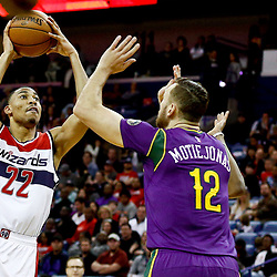 Jan 29, 2017; New Orleans, LA, USA; Washington Wizards forward Otto Porter Jr. (22) shoots over New Orleans Pelicans forward Donatas Motiejunas (12) during the second quarter of a game at the Smoothie King Center. Mandatory Credit: Derick E. Hingle-USA TODAY Sports