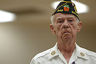 A World War II veteran stands at attention during a reading of the names of deceased comrades at a Veteran's Day ceremony in Sun City Center, Florida.