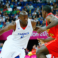 08 August 2012: France Ali Traore drives past Serge Ibaka during 66-59 Team Spain victory over Team France, during the men's basketball quarter-finals, at the 02 Arena, in London, Great Britain.