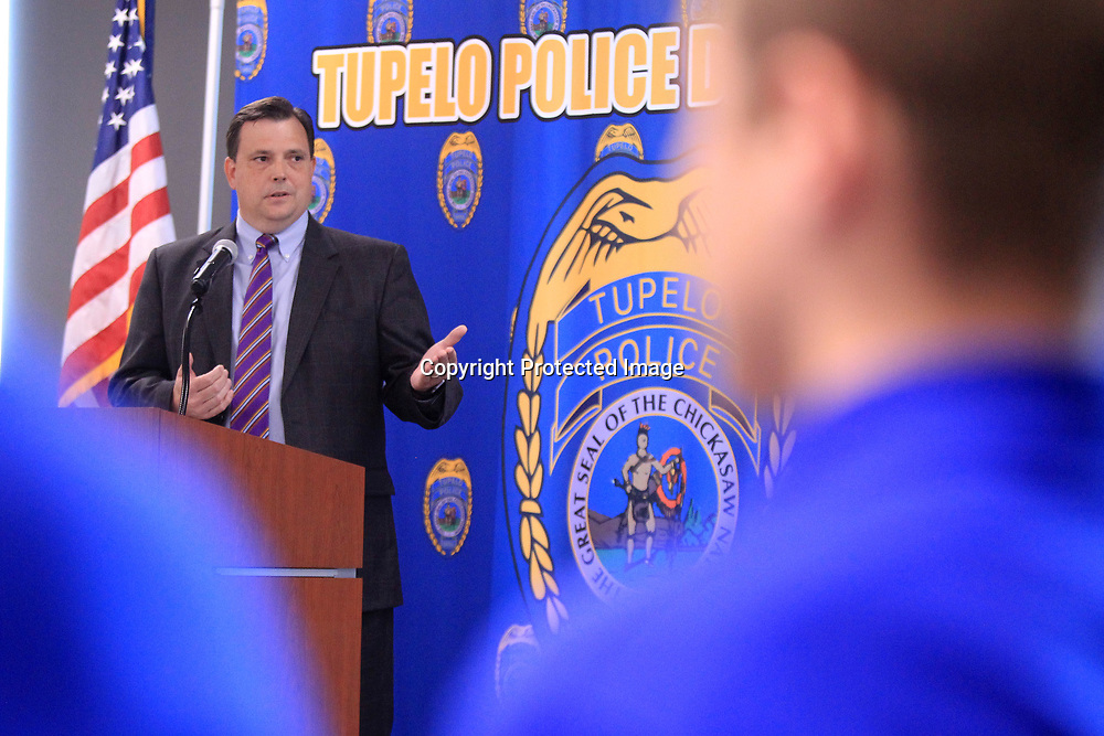 John Weddle, District Attorney, speaks to the cadets during their graduation Friday mornnig in the community room of the Tupelo Police Department. The Tupelo Police Department graduated 22 cadets from the Junior Police Academy Friday morning.