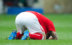 WREXHAM, WALES - Monday, May 7, 2012: Wrexham's Adrian Cieslewicz looks dejected as his side lose 3-2 on aggregate (2-1) to Luton Town during the Football Conference Premier Division Promotion Play-Off 2nd Leg at the Racecourse Ground. (Pic by David Rawcliffe/Propaganda)