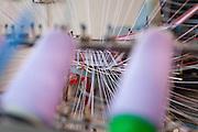Soveria Mannelli (CZ). Lanificio Leo. Particolare dell'orditoio. Con questa macchina si organizzano minuziosamente i fili che compongono l'ordito, la base verticale di ogni tessuto.