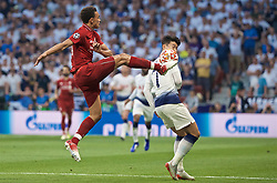 MADRID, SPAIN - SATURDAY, JUNE 1, 2019: Liverpool's Trent Alexander-Arnold (L) and Tottenham Hotspur's Son Heung-min (R) during the UEFA Champions League Final match between Tottenham Hotspur FC and Liverpool FC at the Estadio Metropolitano. (Pic by David Rawcliffe/Propaganda)