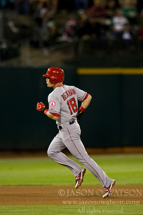 OAKLAND, CA - SEPTEMBER 23:  Gordon Beckham #18 of the Los Angeles Angels of Anaheim rounds the bases after hitting a home run against the Oakland Athletics during the sixth inning at O.co Coliseum on September 23, 2014 in Oakland, California. The Los Angeles Angels of Anaheim defeated the Oakland Athletics 2-0.  (Photo by Jason O. Watson/Getty Images) *** Local Caption *** Gordon Beckham