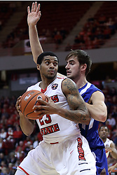 20 January 2017:  Deontae Hawkins(23) backs in against defender Niels Bunschoten during an NCAA Missouri Valley Conference mens basketball game Where the Purple Aces of Evansville lost to the Illinois State Redbirds 75-73 in Redbird Arena, Normal IL