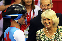Image licensed to i-Images Picture Agency. 23/07/2014. Glasgow, United Kingdom. The Duchess of Cornwall talks to a cyclist during a visit to the velodrome at the Commonwealth Games in Glasgow  Picture by Stephen Lock / i-Images