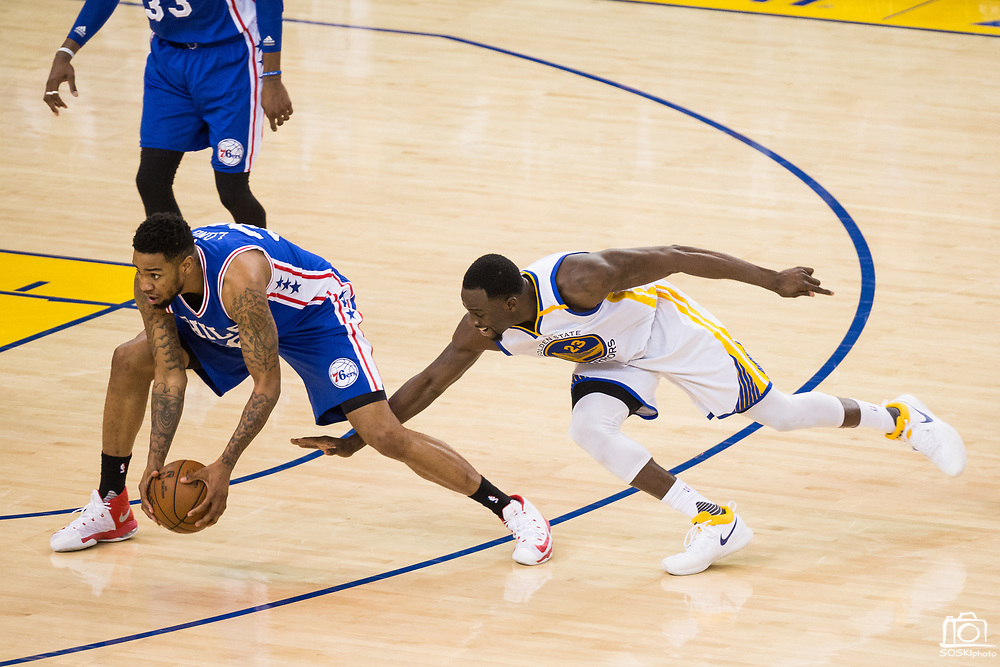 Golden State Warriors forward Draymond Green (23) dives for a loose ball against Philadelphia 76ers forward Shawn Long (36) at Oracle Arena in Oakland, Calif., on March 14, 2017. (Stan Olszewski/Special to S.F. Examiner)