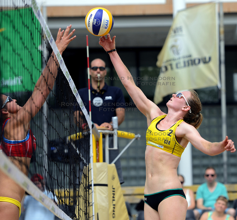 16-07-2014 NED: FIVB Grand Slam Beach Volleybal, Apeldoorn<br /> Poule fase groep G vrouwen - Julia Sude GER