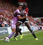 Hal Robson-Kanu (Robson Kanu) (Reading midfielder) sturggling to hold of Toumani Diagouraga (Brentford midfielder) during the Sky Bet Championship match between Brentford and Reading at Griffin Park, London, England on 29 August 2015. Photo by Matthew Redman.