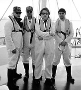 U2 Band with manager Paul McGuiness on a boat trip to a radioactive Sellafield beach dressed in anti radiation suits for a 1992 Greenpeace Demo.