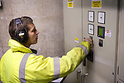 Engineer checking power levels at Hydro plant in Powys, Wales. Hydroelectricity is a form of hydropower, and is the most widely used form of renewable energy. It produces no waste, and does not produce carbon dioxide (CO2) which contributes to greenhouse gases.