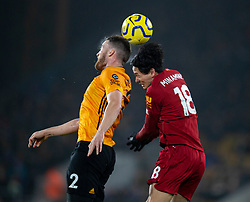 WOLVERHAMPTON, ENGLAND - Thursday, January 23, 2020: Liverpool's Takumi Minamino (R) challenges for a header with Wolverhampton Wanderers' Matt Doherty during the FA Premier League match between Wolverhampton Wanderers FC and Liverpool FC at Molineux Stadium. (Pic by David Rawcliffe/Propaganda)
