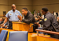 Happy Johnson,speaking against Entergy's proposed natural gas power plant in New Orleans East at a New Orleans City Council meeting. The city voted to approve Entergy's project despite a lot of opposition. The City Council is now facing lawsuits over its decision.
